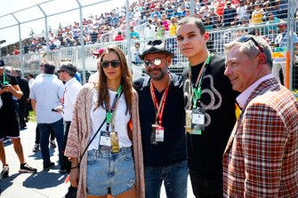 Guy Laliberte, Businessman and Poker Player, centre, with guests on the grid