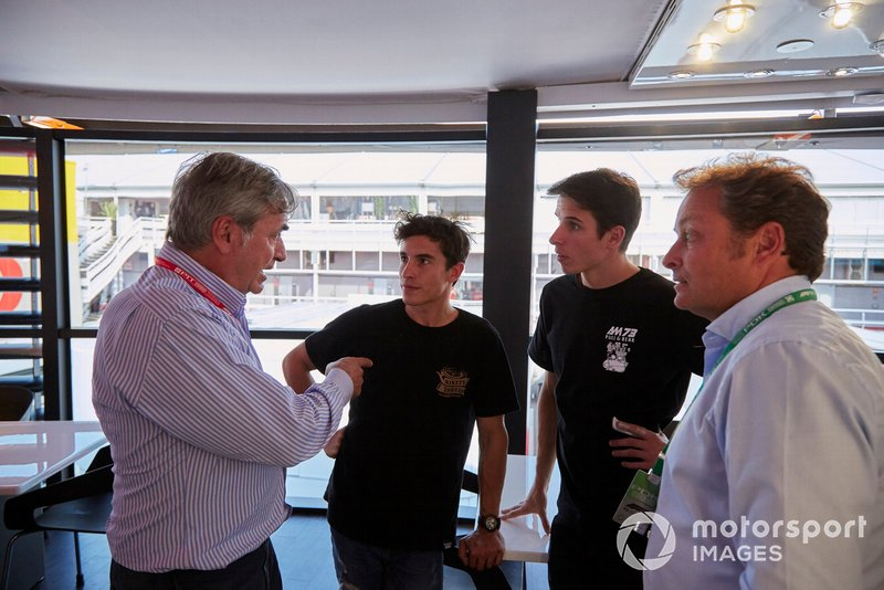 Moto GP riders Alex and Marc Marquez talk to Carlos Sainz Snr.