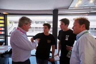 Moto GP riders Alex and Marc Marquez talk to Carlos Sainz Snr.