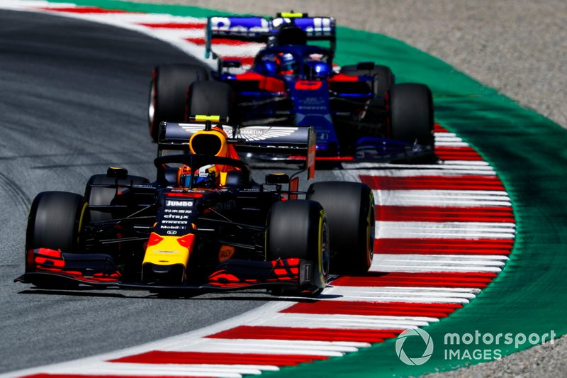 Pierre Gasly, Red Bull Racing RB15, leads Alexander Albon, Toro Rosso STR14