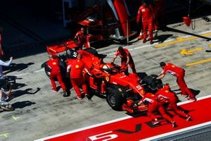 Sebastian Vettel, Ferrari SF90, is returned to the garage