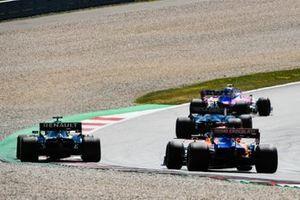 Lance Stroll, Racing Point RP19, leads Kevin Magnussen, Haas F1 Team VF-19, Daniel Ricciardo, Renault F1 Team R.S.19, and Carlos Sainz Jr., McLaren MCL34