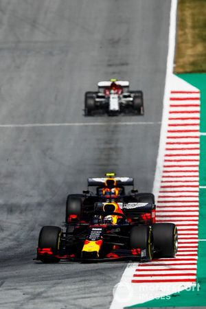 Max Verstappen, Red Bull Racing RB15, leads Pierre Gasly, Red Bull Racing RB15, and Antonio Giovinazzi, Alfa Romeo Racing C38