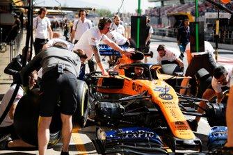 The McLaren team practice their pit stop drill