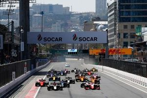 Nikita Mazepin, ART Grand Prix, and Sean Gelael, PREMA RACING, lead at the start of the race