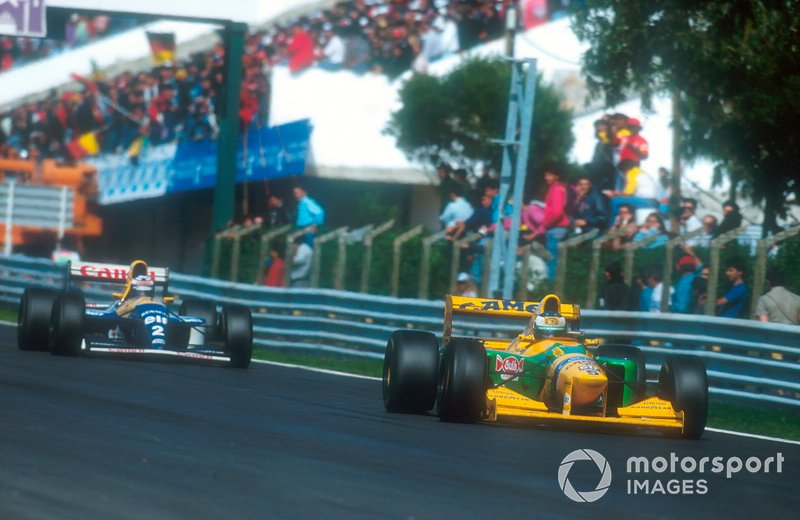Michael Schumacher, Benetton B193B followed by Alain Prost, Williams FW15C