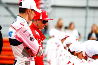 Esteban Ocon, Racing Point Force India, andKimi Raikkonen, Ferrari, on the grid with the Grid Kid mascots