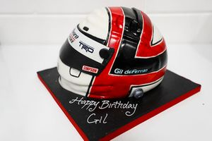 A Marlboro Team Penske crash helmet birthday cake for Gil de Ferran, Sporting Director, McLaren