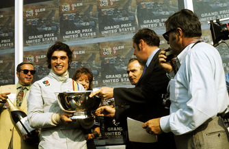 A jubilant Francois Cevert, Tyrrell celebrates his first GP victory on the podium