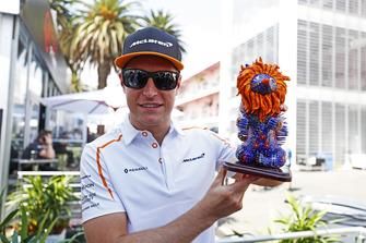 Stoffel Vandoorne, McLaren, holds an Alebrijes sculpture