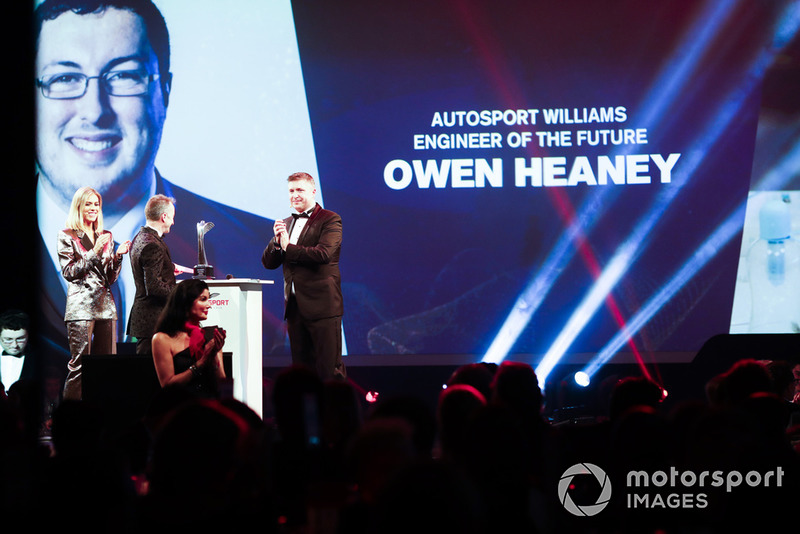 Nicki Shields and David Croft on stage with Paddy Lowe to present the Autosport Williams Engineer of the Future Award to Owen Heaney