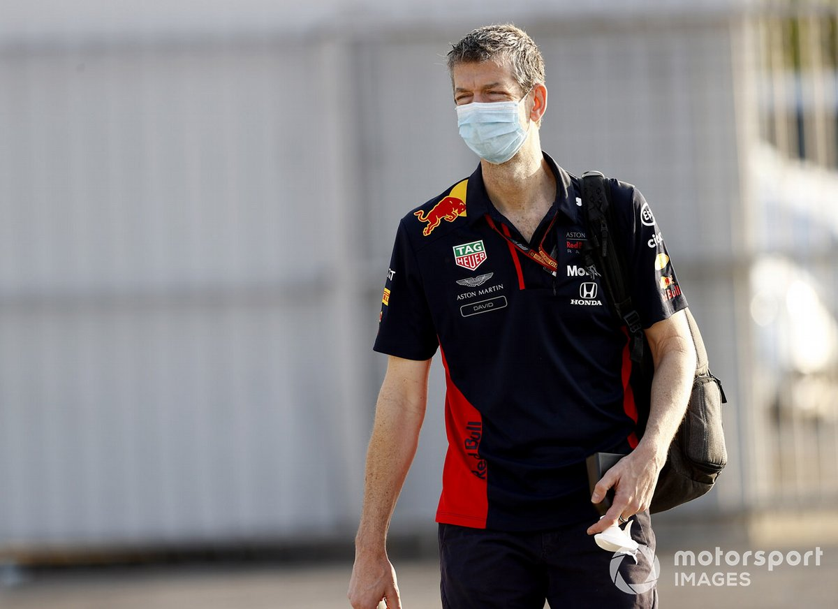 Red Bull team members arrive at the track