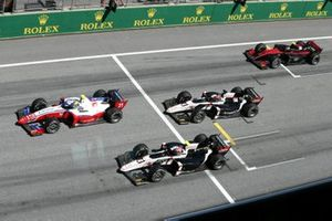 Robert Shwartzman, Prema Racing, leads Christian Lundgaard, ART Grand Prix, Marcus Armstrong, ART Grand Prix, and Callum Ilott, UNI-Virtuosi, at the start of the race