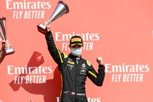 Christian Lundgaard, ART Grand Prix, lifts his trophy on the podium