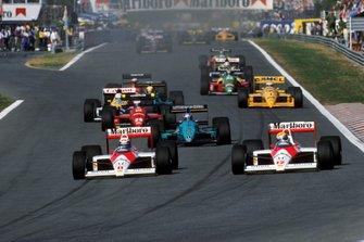 Alain Prost, and team mate Ayrton Senna, McLaren MP4/4 at the start