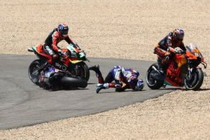 Miguel Oliveira, Red Bull KTM Tech 3 and Brad Binder, Red Bull KTM Factory Racing crash on the opening corner