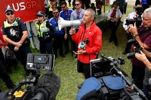A member of the Australian Grand Prix Corporation makes an announcement
