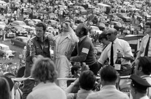 Race winner Jochen Rindt on the victory lap with Colin Chapman