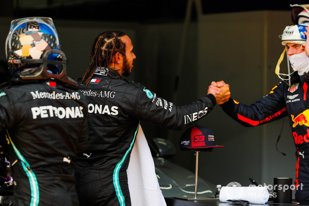 Winner Lewis Hamilton, Mercedes-AMG Petronas F1, congratulates Max Verstappen, Red Bull Racing as Valtteri Bottas, Mercedes-AMG Petronas F1 looks on