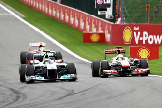 Nico Rosberg, Mercedes GP MGP W02 and Lewis Hamilton, McLaren MP4/26