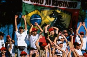 Rubens Barrichello fans in the grandstand