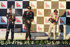 Podium: race winner Sebastian Vettel, Red Bull Racing, second place Lewis Hamilton, McLaren, third place Vitaly Petrov, Lotus Renault GP