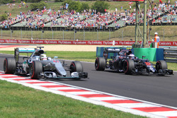 Lewis Hamilton, Mercedes AMG F1, W07 Hybrid; Jenson Button, McLaren-Honda, MP4-31