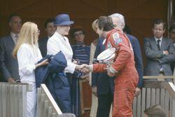 Podium: race winner Carlos Reutemann, Williams FW07B with Prince Rainier and Princess Grace of Monaco