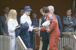 Podium: race winner Carlos Reutemann, Williams FW07B with Prince Rainier and Princess Grace of Monac