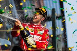 Sebastian Vettel, Ferrari, 1st Position, sprays Champagne on the podium