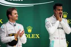 The podium (L to R): second placed Nico Rosberg, Mercedes AMG F1 with team mate and race winner Lewi