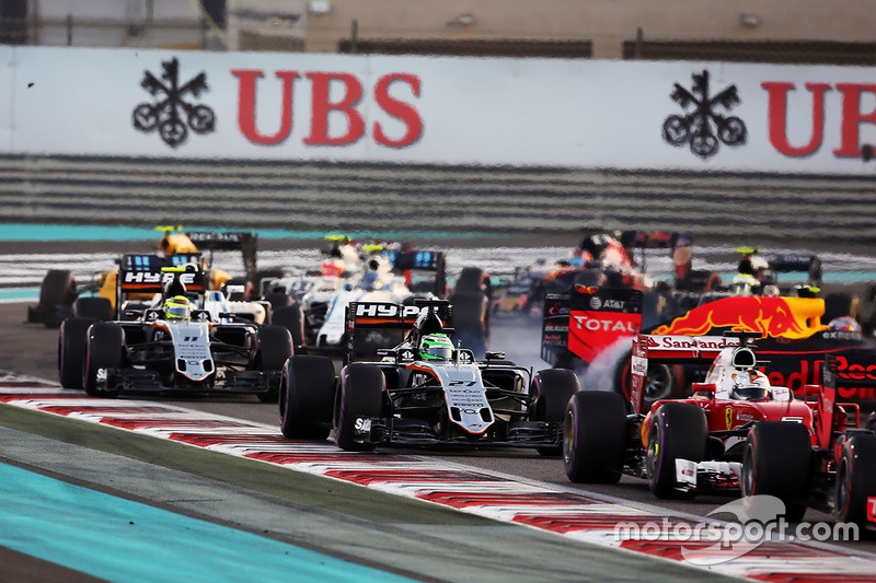 Nico Hulkenberg, Sahara Force India F1 VJM09 at the start of the race as Max Verstappen, Red Bull Racing RB12 spins