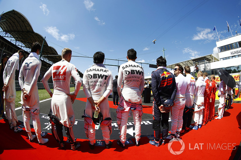 The drivers stand to attention for the national anthem. L-R: paul di Resta, Lance Stroll, Williams, Kevin Magnussen, Haas F1 Team, Sergio Perez, Force India, Esteban Ocon, Force India, Carlos Sainz Jr., Scuderia Toro Rosso, Fernando Alonso, McLaren, Daniil Kvyat, Scuderia Toro Rosso, Valtteri Bottas, Mercedes AMG F1 and Sebastian Vettel, Ferrari