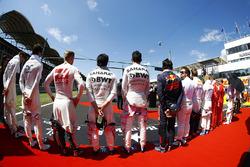 The drivers stand to attention for the national anthem. L-R: paul di Resta, Lance Stroll, Williams, Kevin Magnussen, Haas F1 Team, Sergio Perez, Force India, Esteban Ocon, Force India, Carlos Sainz Jr., Scuderia Toro Rosso, Fernando Alonso, McLaren, Daniil Kvyat, Scuderia Toro Rosso, Valtteri Bottas, Mercedes AMG F1 and Sebastian Vettel, Ferrari