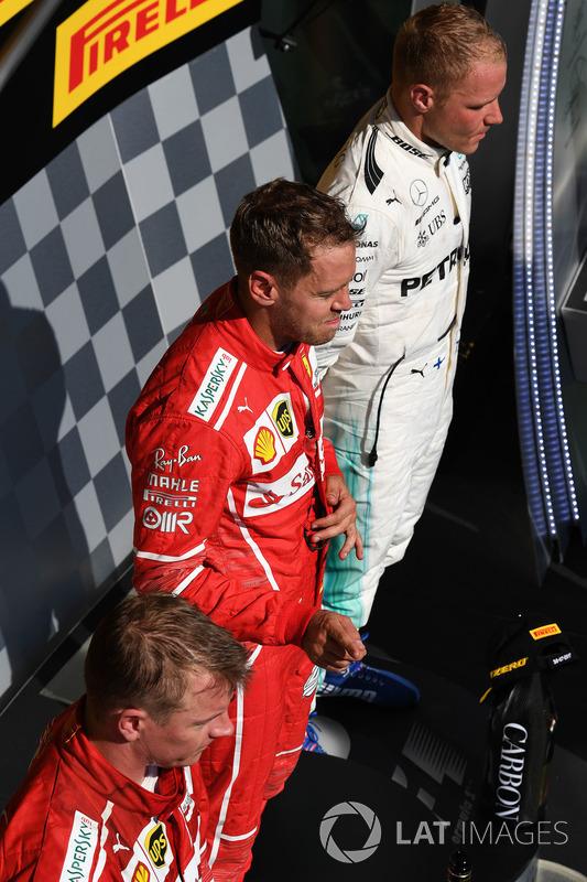 Podio: ganador de la carrera Sebastian Vettel, Ferrari, Kimi Raikkonen, Ferrari el segundo lugar y tercer lugar Valtteri Bottas, Mercedes AMG F1