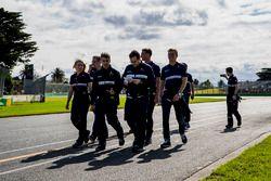 Saucer team members walk the track, including Marcus Ericsson, Sauber