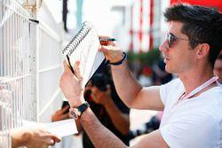 Robert Lewandowski signs autographs for fans