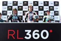 RL360º Superstock TT race winner Peter Hickman celebrates with runner up Michael Dunlop and third pl