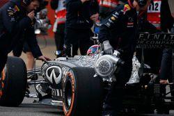 The Red Bull team push Daniil Kvyat, Red Bull Racing RB11, back to his garage
