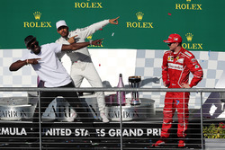 Race winner Lewis Hamilton, Mercedes AMG F1 celebrates on the podium with Usain Bolt, third place Kimi Raikkonen, Ferrari