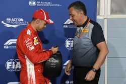 Sebastian Vettel, Ferrari receives the Pirelli Pole Position award from Mario Isola, Pirelli Sporting Director