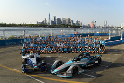 Alejandro Agag, CEO, Formula E, the other staff pose for a picture with the old, new cars