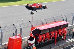 Sebastian Vettel, Ferrari SF71H passes Ferrari pit wall gantry