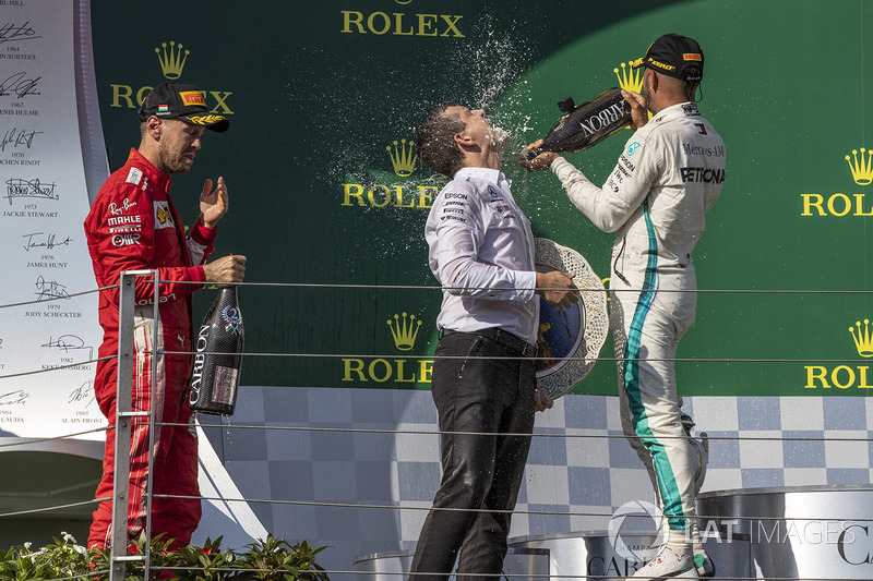 Sebastian Vettel, Ferrari and Lewis Hamilton, Mercedes-AMG F1 celebrate on the podium with the champagne