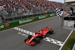 Race winner Sebastian Vettel, Ferrari SF71H takes the chequered flag
