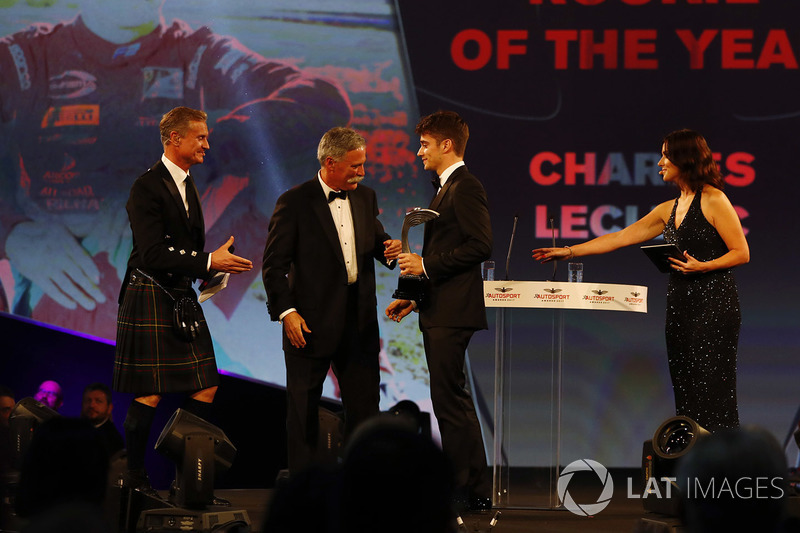 Charles Leclerc receives his rookie of the year award from Chase Carey, Chairman, Formula One