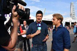 TV Presenter Vernon Kaye, Nico Rosberg in the paddock