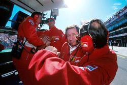 Ferrari team personnel on the pitwall: Ross Brawn, Ferrari Technical Director, Michael Schumacher, F