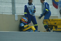 Fernando Alonso, Renault Renault F1 Team R23, sitting down with the wrecked car