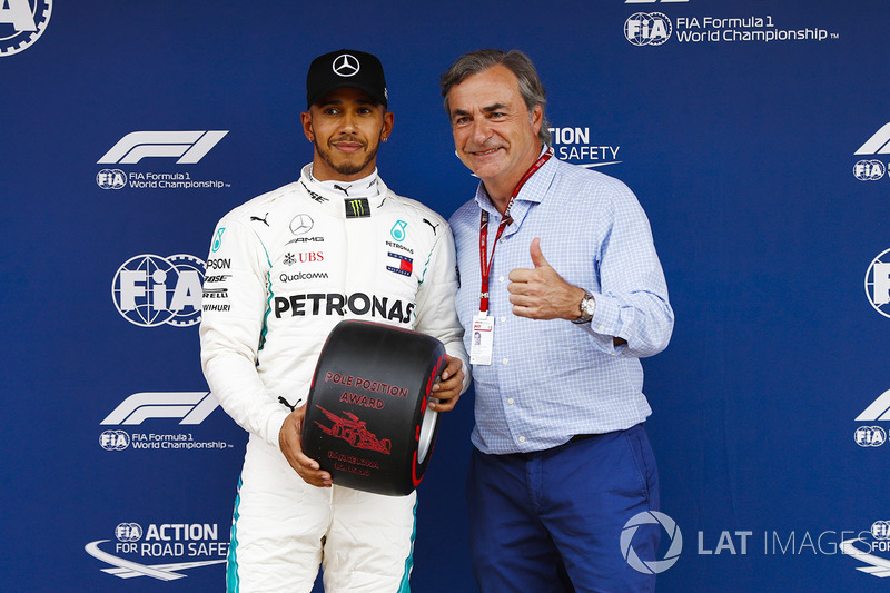 Lewis Hamilton, Mercedes AMG F1, celebrates pole position with Carlos Sainz